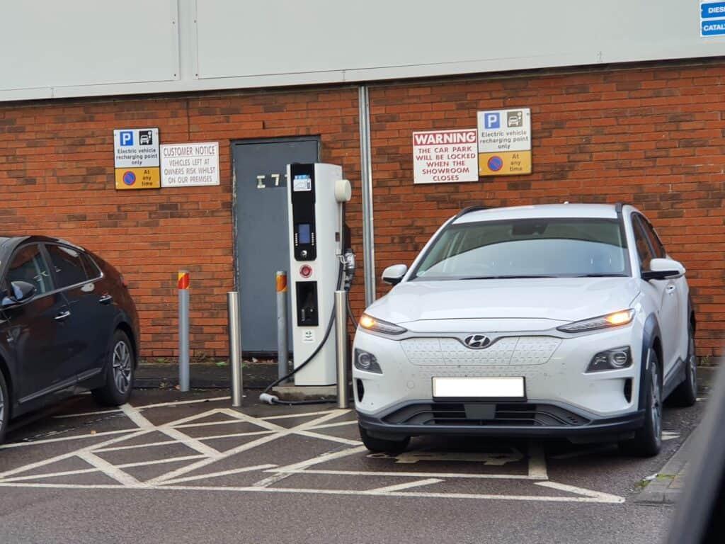 Hyundai Kona EV next to a EVSE charging station
