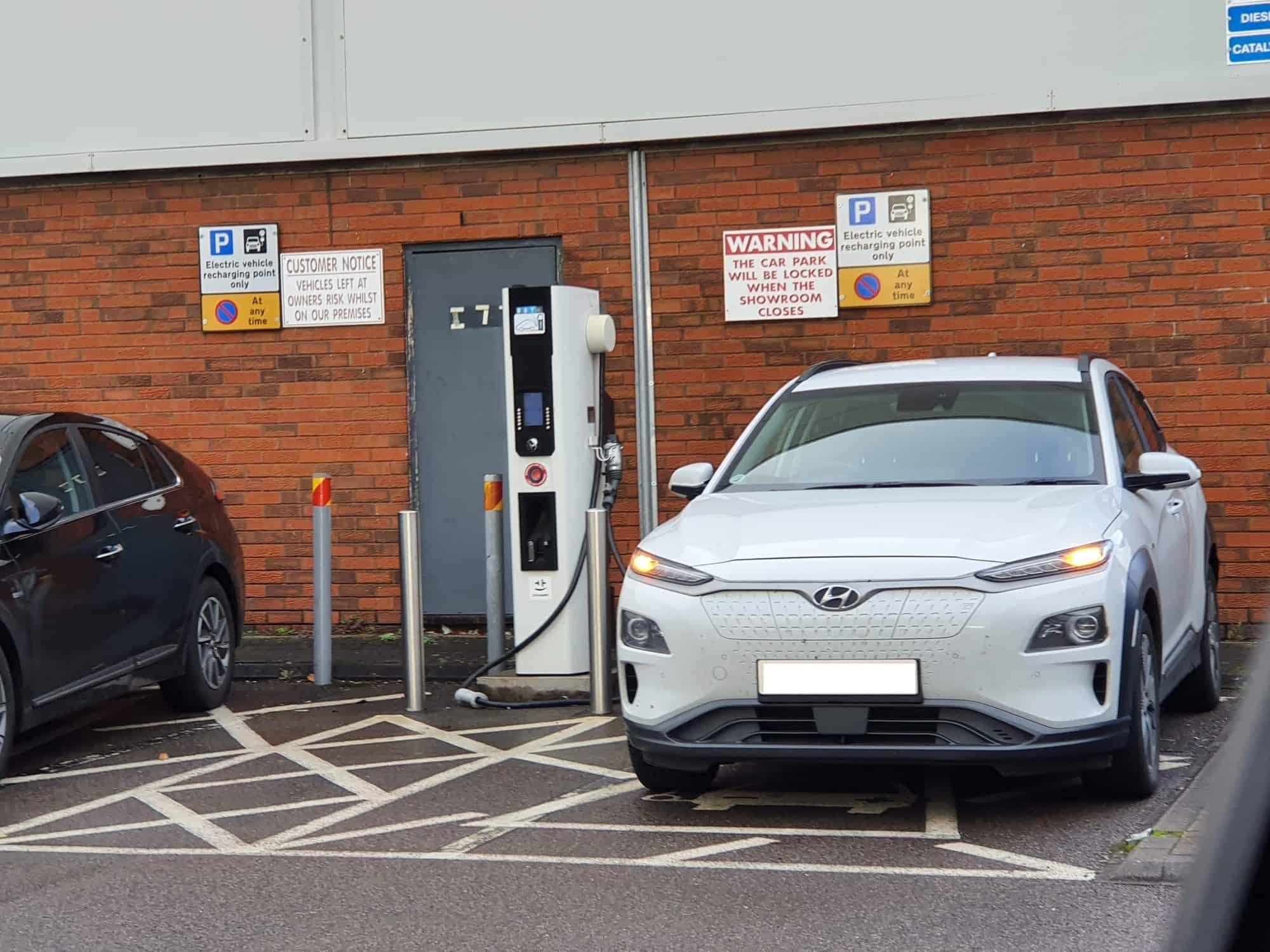 Hyundai Kona EV next to a EVSE charging station