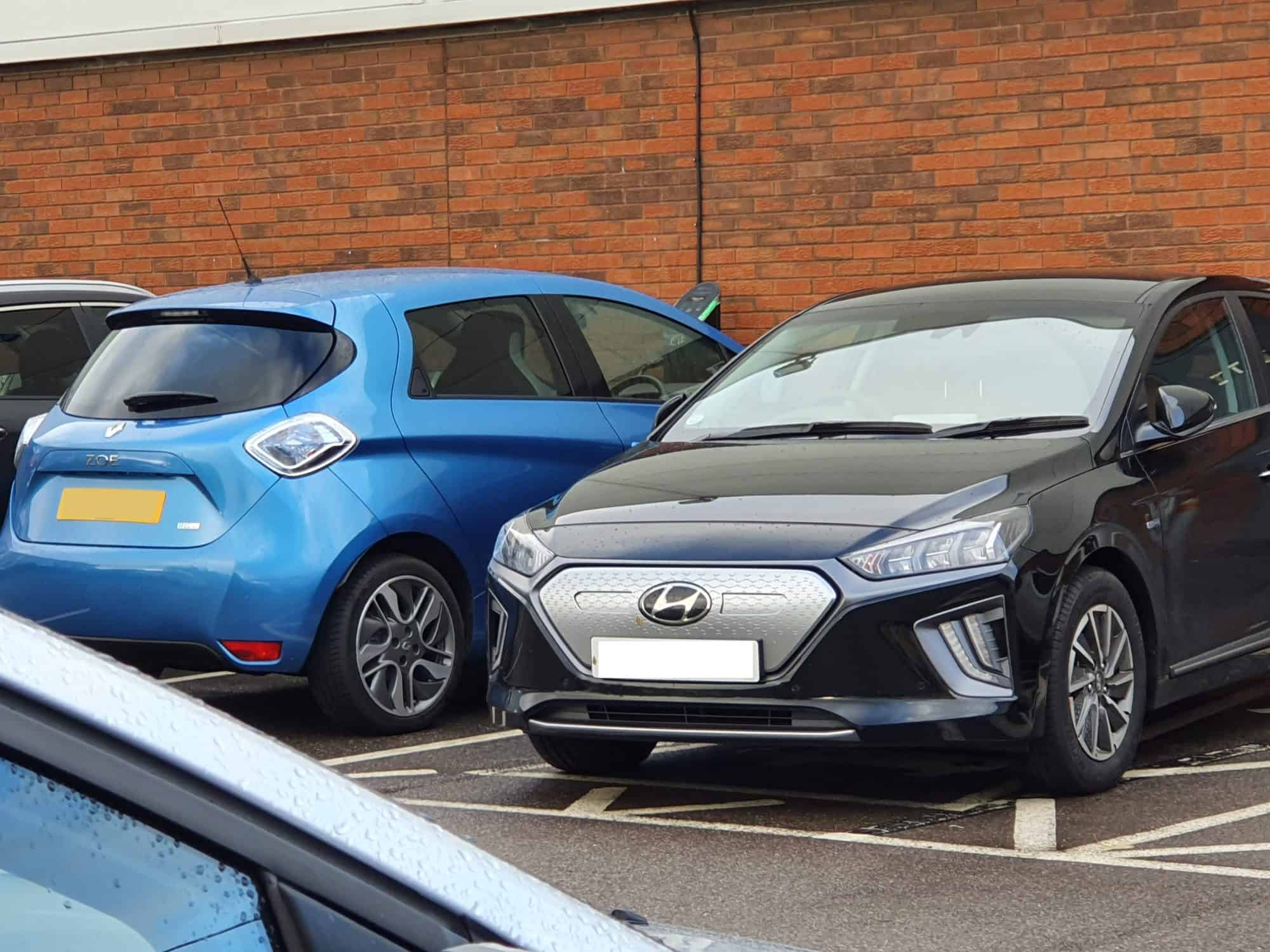 Renault Zoe and Hyundai IONIQ EVs next to each other