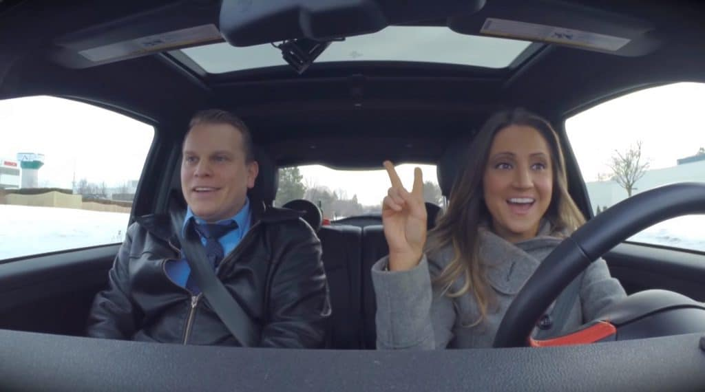 Two people driving in an EV for the first time