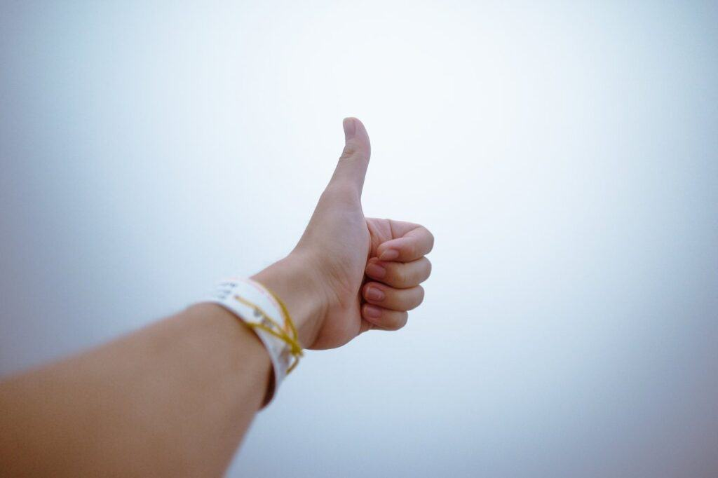 A person doing the thumbs up sign