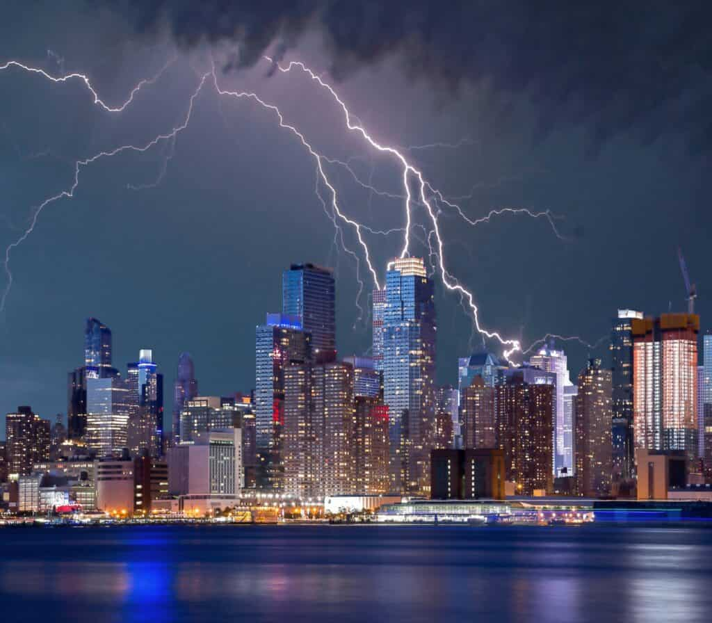 A city being hit by a lightning storm