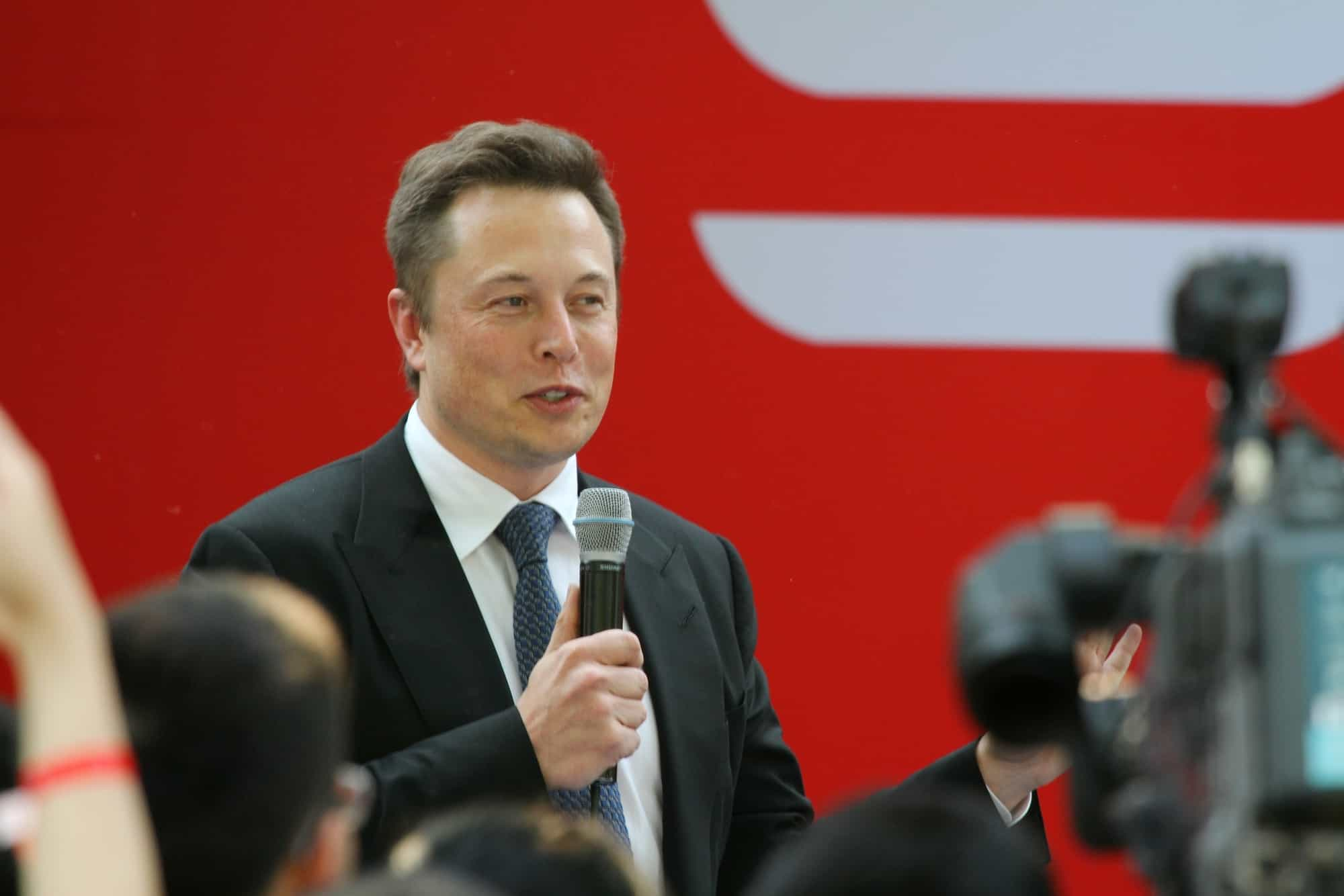 Elon Musk, CEO of Tesla Motors Inc., speaks during a delivery ceremony for Tesla Model S sedan in Beijing, China, 22 April 2014.