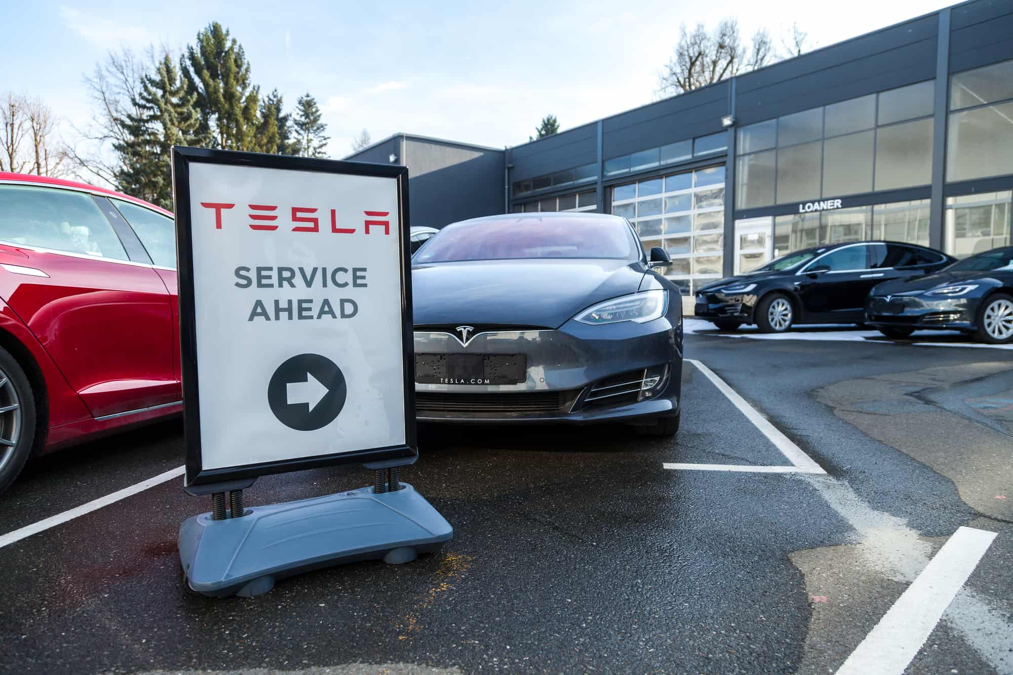 Tesla service ahead sign outside a dealership in Germany