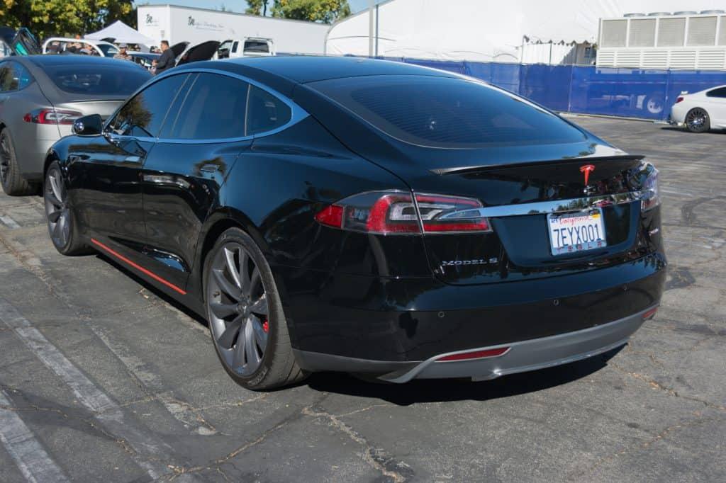 Tesla Model S on the side in a car park