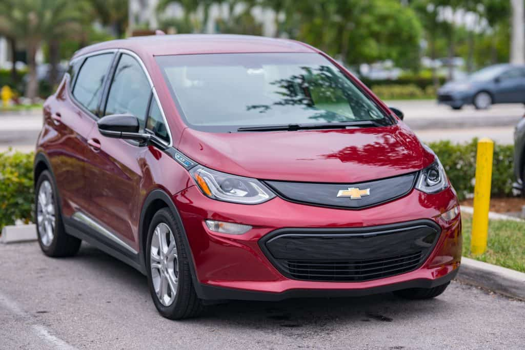 A Chevrolet Bolt Chevy Bolt full EV parked in a parking space