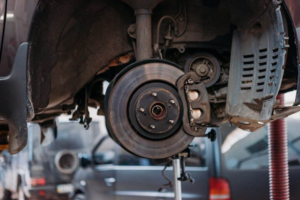 A car with a tire removed to show the entire car brake shoe