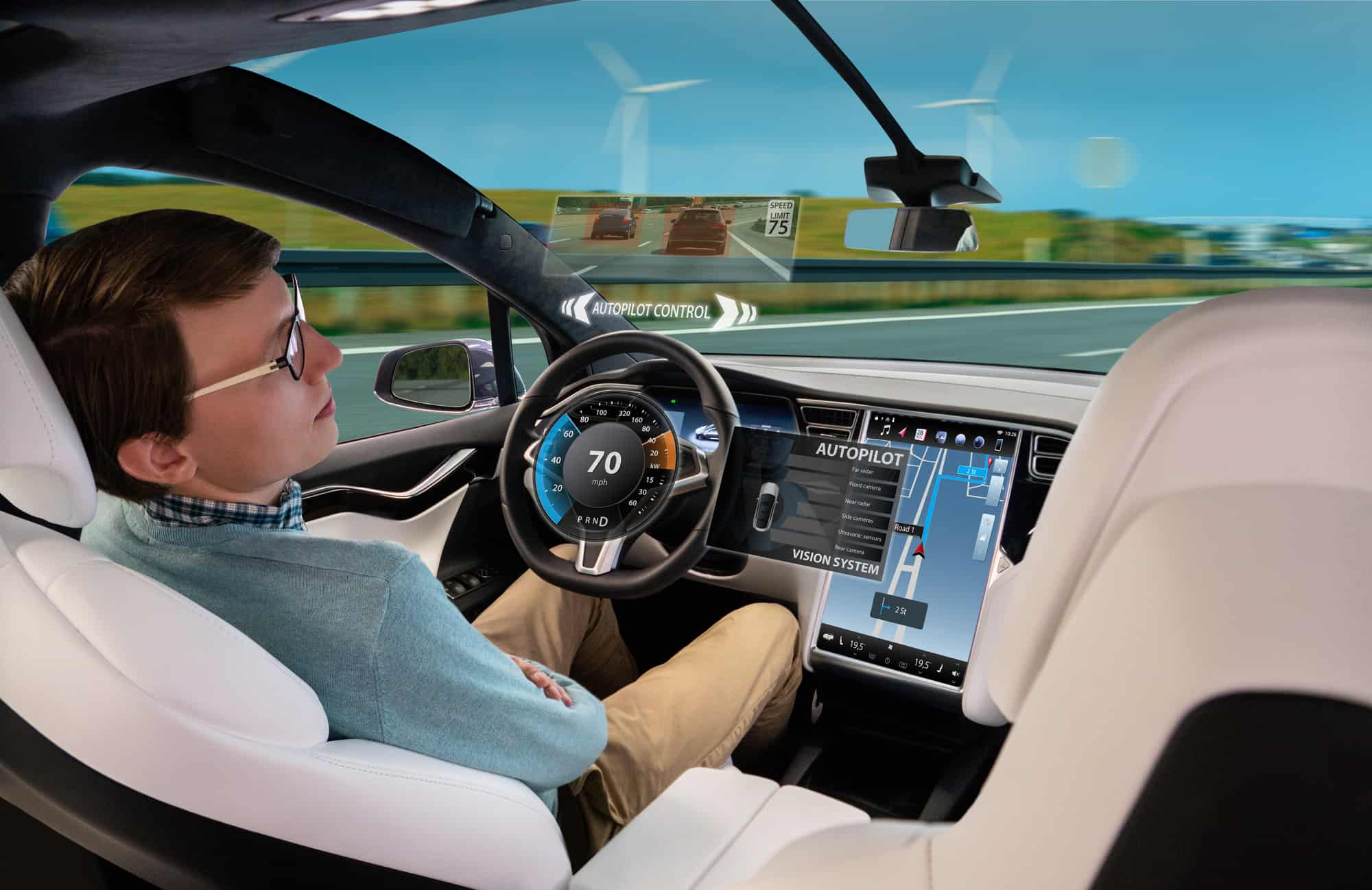 A mockup of someone asleep at the wheel with the EV on autopilot