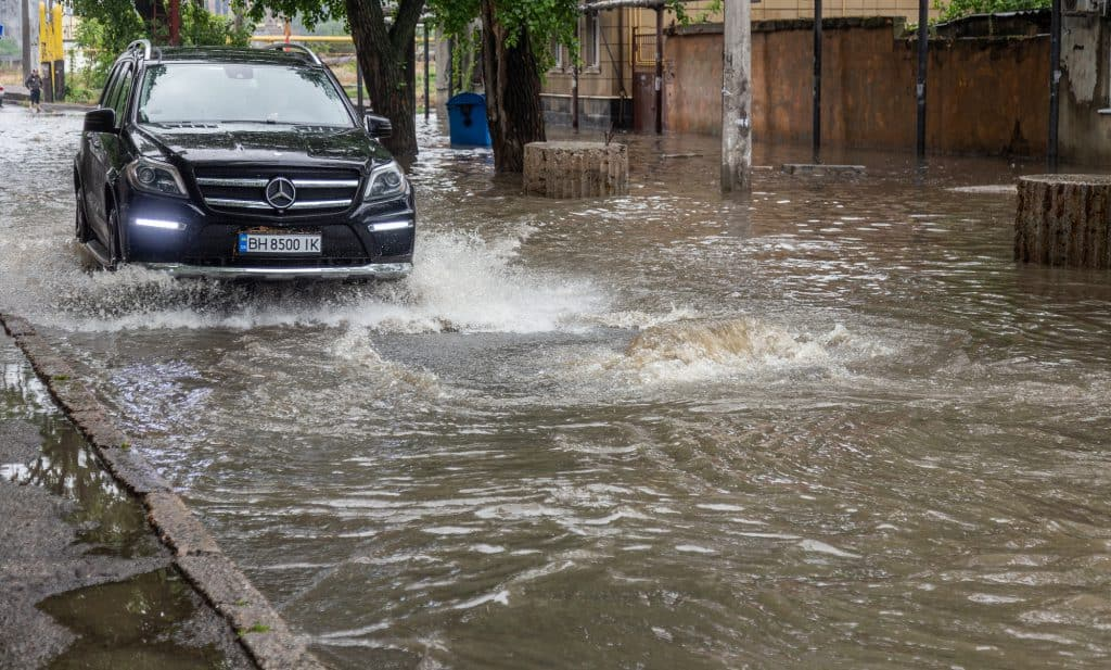 Driving a Mercedes through shallow surface water