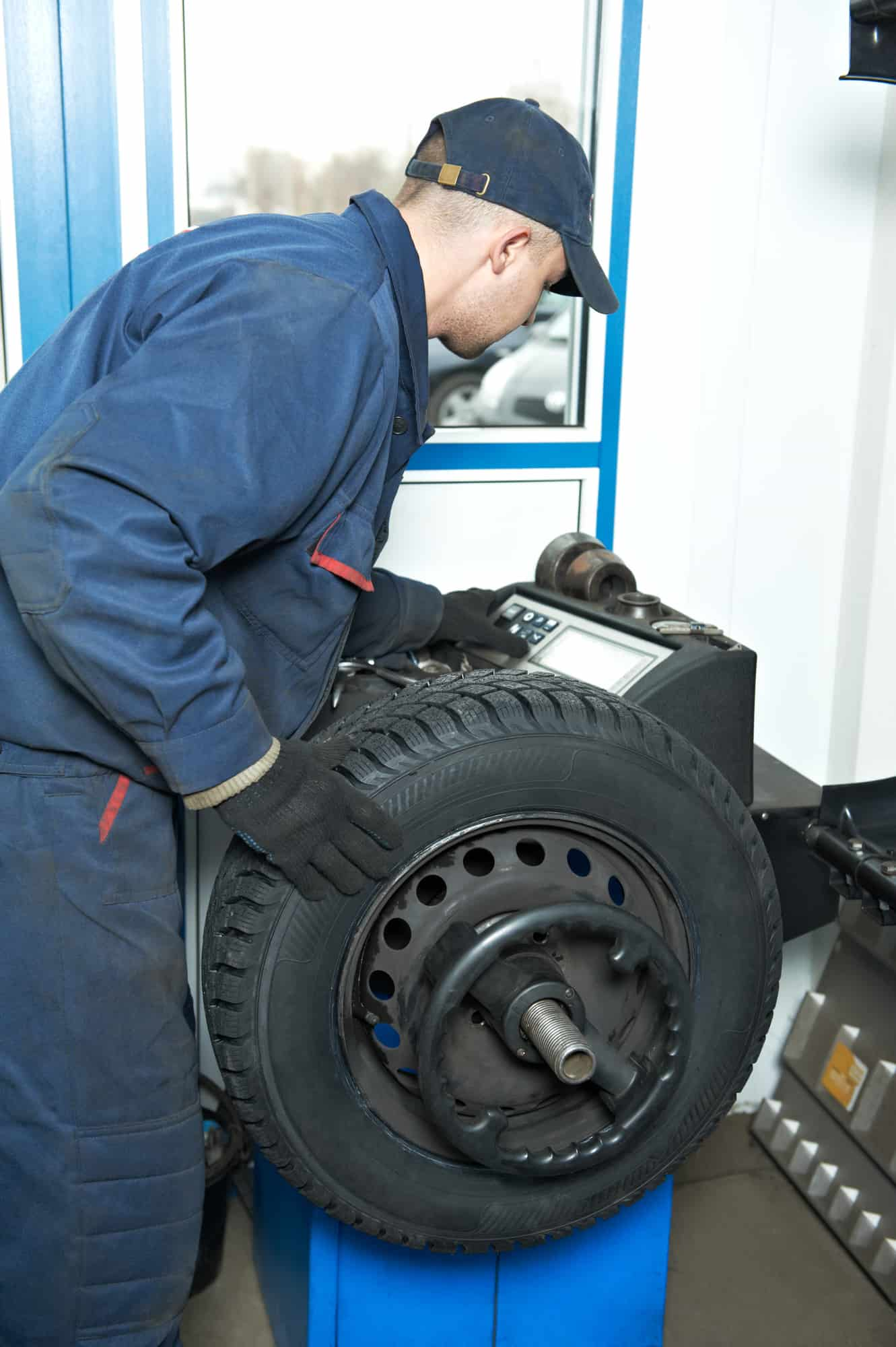 A mechanic changing and balancing a tire