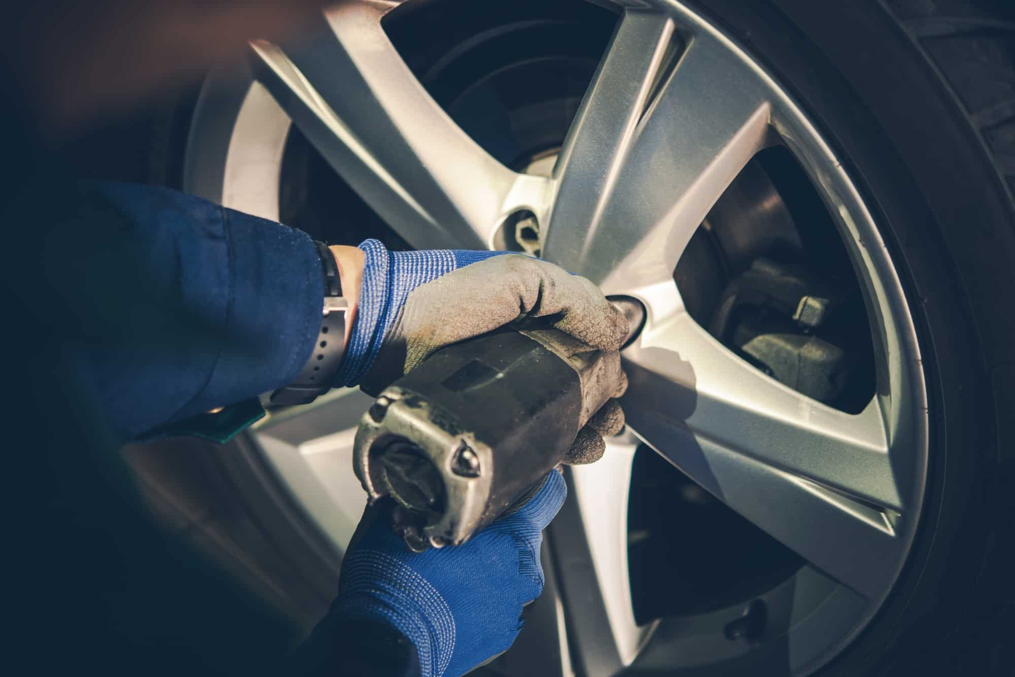 A winter tire being changed