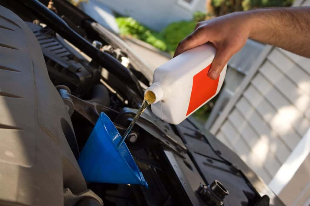 Oil being changed in a gasoline powered car