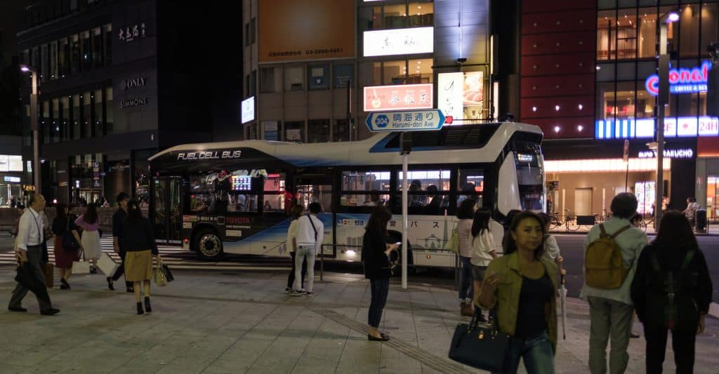 Toyotas Fuel Cell Bus going around its designated route in Ginza street at night